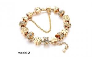 Bratara Charm Gold Sparkling , placata cu 3 straturi de aur 18K, cu talismane norocoase si insertii cristale austriece, 3 modele la alegere - un cadou deosebit.