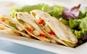 Quesadilla Maxi Pizza (gratinata delicios cu Mozarella) + 2x Portii de Aripioase Krispy + 2x Portii desert + 2x Sosuri, pentru doar 11 RON in loc de 35 RON
